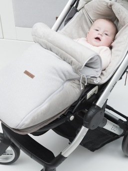 A larger footmuff designed for strollers. The tfootmuff keeps the baby warm for even longer rides and when the child is sleeping on the stroller. The footmuff has a handy zipper that can be easily open and close.  The footmuff has openings for the five-point harness. The footmuff fits perfectly to all the stroller models.