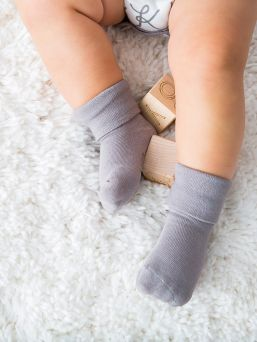 Babysoy Soy soft baby socks do not squeeze and leave nasty marks on the baby's skin, but they still stay well on baby's little feet. The soft stem of the sock is sturdy but the stem does not push the baby's delicate skin.
