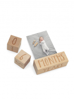Wooden Mamas & Papas age blocks for baby photography. The blocks tell in the photo the child's age in delightful way.