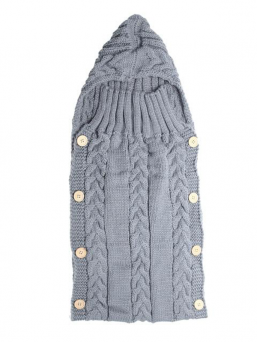 A soft and beautiful wool sleeping bag keeps the baby warm in cradle or wagons, and it is the most beautiful item at the babyshoot.  The wool sleeping bag is suitable for infants up to 3 months of age. On the side of the knit bag, there are four beautiful wood buttons in great detail.