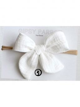 Beautiful and adorable Gipsyparrot Muslin collection bow headwrap for baby. All bow headwraps are made by hand. The fabrics are soft and the headband does not tighten or squeeze the baby's head.