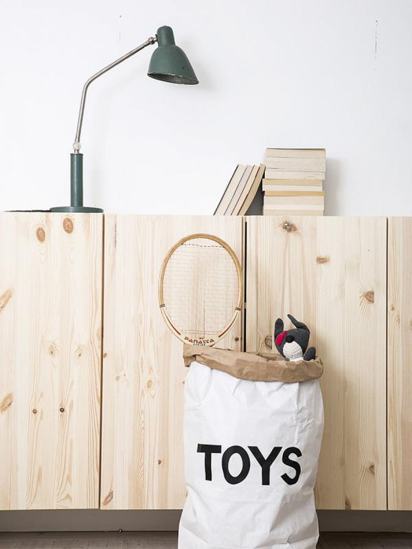 This gorgeous Tellkiddo toy sack is made of recycled paper, white and brown. Durable and reusable many times over. Once placed and arranged into shape, the paper bag becomes a design object in any kids room.