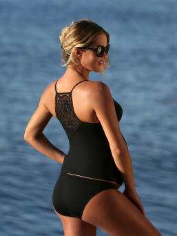 Stunning two-piece Cache Coeur Maori maternity tankini, inspired by the traditional Polynesian tattoo. This swimsuit combines dark coloring, a beautiful neckline and an Italian lace.
