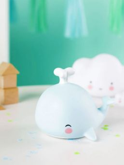 This little A little lovely company whale is oh so lovely and is right at home on your little one's nightstand. The light glows softly and helps your little one fall asleep.