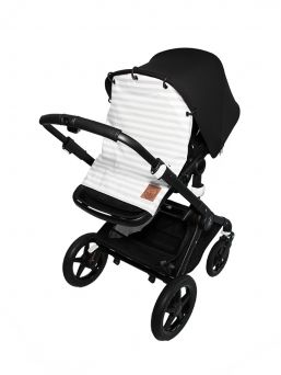 Grey and white pram curtain protects the sleeping baby from wind, traffic noise and pollution. The pram curtain also acts as a sunscreen for the sensitive skin of the baby.
