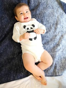 Soft and comfortable Kurtis Baby Peace baby long-sleeved body with Panda pattern.